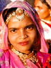 Young woman dressed up at the Mewar or Gangaur Festival in Udaipur, Rajasthan, India