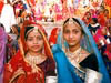 Young women dressed up at the Mewar or Gangaur Festival in Udaipur, Rajasthan, India