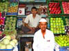 Man by his fruit and vegetable stall in Crawford Market, Mumbai, India